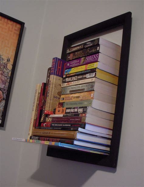 An Invisible Bookshelf Plus An Empty Picture Frame Invisible Bookshelves