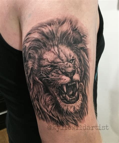 lion roaring tattoo roaring on arm by heslop canberra