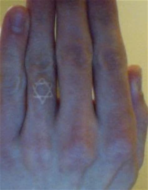 finger tattoo history star of david finger tattoo