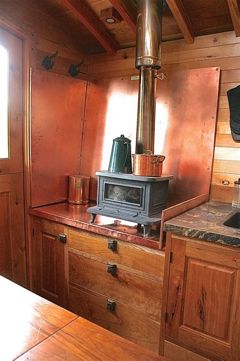 tiny house wood burning stove marine wood burning stove in this small kitchen that copper back piece is pretty cool