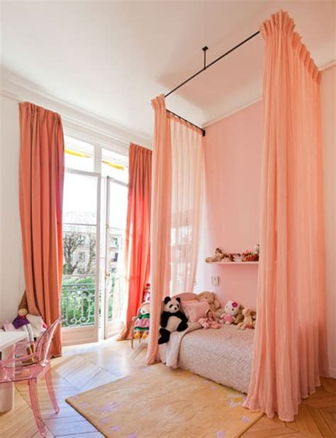 bed with curtains around it ceiling mounted bed curtains apartment therapy