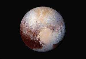 what color is pluto the pluto dazzles in false color inside rms