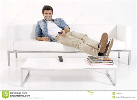 free couch tv single man on the couch watching tv stock photos image