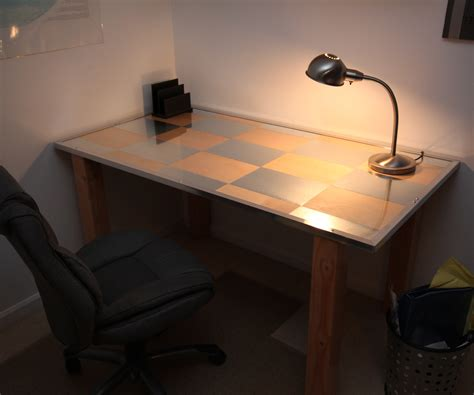 a desk birch and aluminum desk