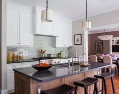 casual kitchen eating area transitional kitchen butcher block eating area overlapping quartz counters and