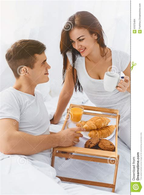 how to be romantic in bed couple having breakfast in bed stock photo image 61075484