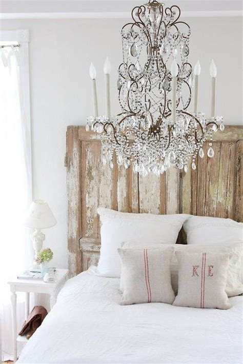wood and linen headboard rustic glamour bedroom chandelier burlap linens aged
