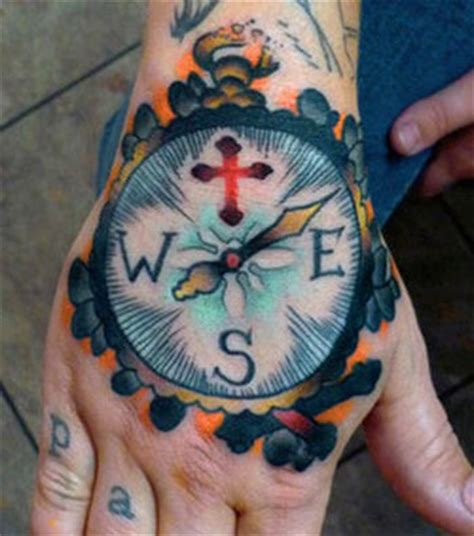compass tattoo on hand meaning compass hand tattoo by bryan reynolds tattoonow