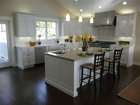 white kitchen wood island kitchen black wooden floor simple chandelier white
