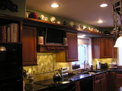 How To Decorate Above Kitchen Cabinets by Decorating Ideas For Kitchen Cabinet Tops Room