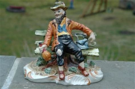 capodimonte man on bench large capodimonte italy figurine man on bench w liquor