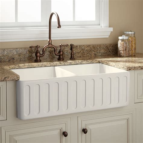 traditional kitchen sinks 33 quot northing double bowl fireclay farmhouse sink biscuit