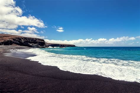 beach with black sand pink sand beach black sand beach and other colorful beaches