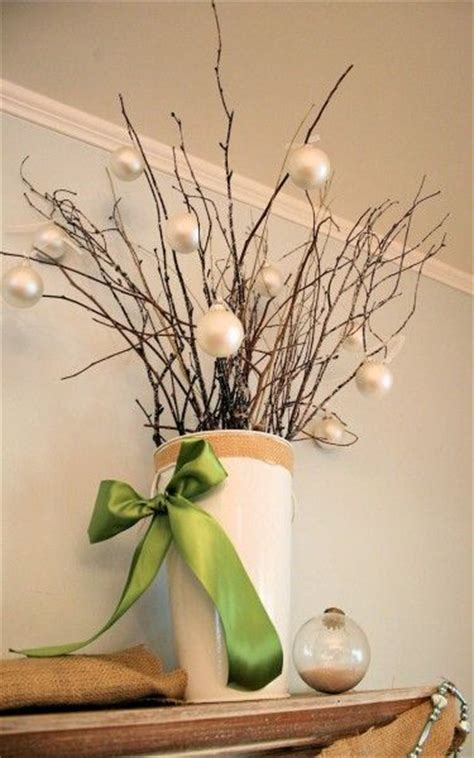 grab branches from outside and hang holiday balls from