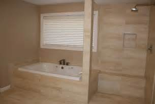 Porcelain travertine look master bath