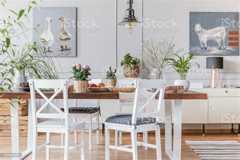 white chairs  wooden table  flowers  eclectic