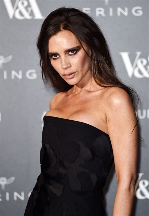 victoria beckham boosts cleavage in strapless gown as she