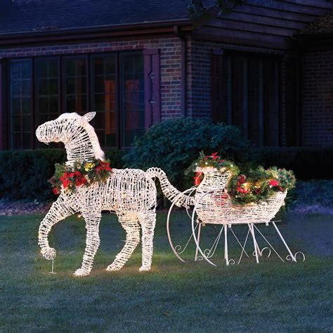the lighted holiday horse drawn sleigh hammacher schlemmer