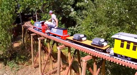 backyard railroad locomotives scale train moving on backyard railway trestle is simply