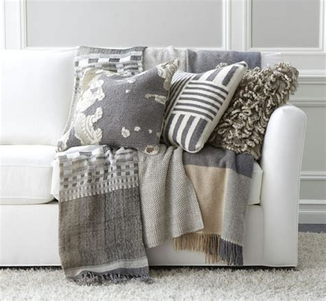 couch with throw contemporary living room area with grey wool material
