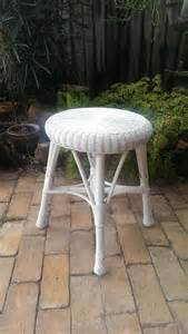 white wicker vanity stool or accent table