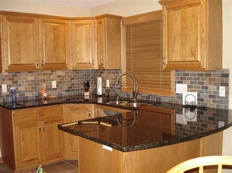 honey oak kitchen cabinets  black countertops