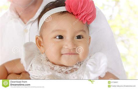 closeup of beautiful baby with flower headband stock photo smiling baby stock photo image 57728337