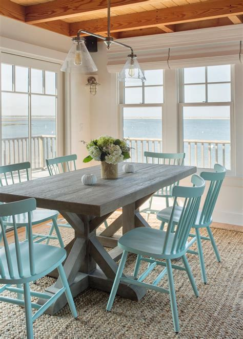 beachy dining table coastal dining room with beachy blue dining chairs hgtv