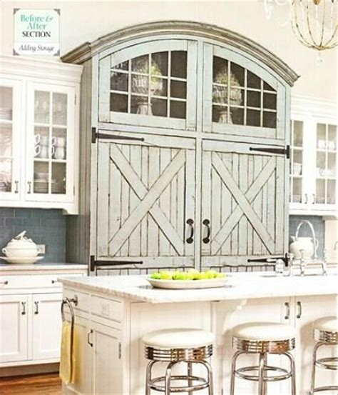 Barn Door Style Kitchen Cabinets This Refrigerator Is Disguised With Distressed Barn Style Doors With Hinges Arched Top