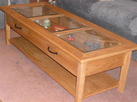 oak and glass coffee table display by johnscripture