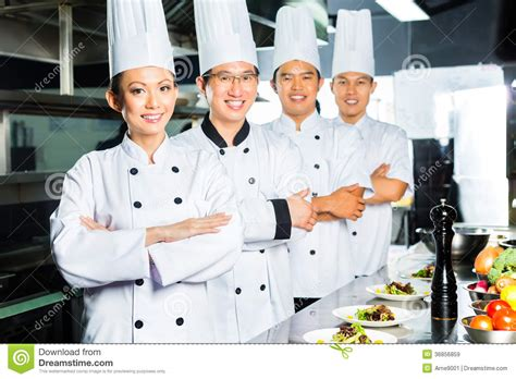 cook s asian chef in restaurant kitchen cooking royalty free