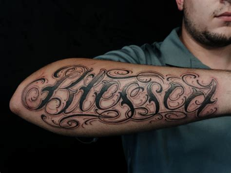 custom lettering on outter forearm tattoo chronic ink