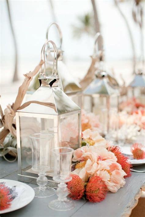 #coral wedding tables   silver lantern centerpieces and