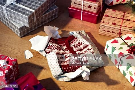 unwrapped christmas jumper and gifts stock photo getty