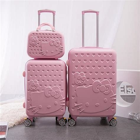 women rolling luggage  fashion abs  kitty travel