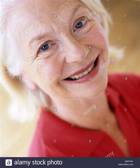 is 63 yos old smiling woman 63 year old woman looking happy stock photo
