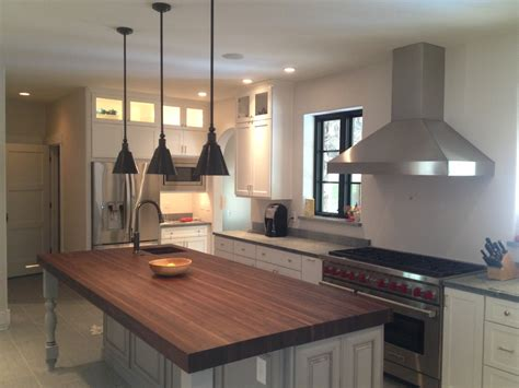large kitchen island with butcher block top and corner