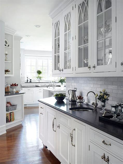white kitchen cabinets with gothic arch glass front doors arched glass front cabinets soapstone countertops