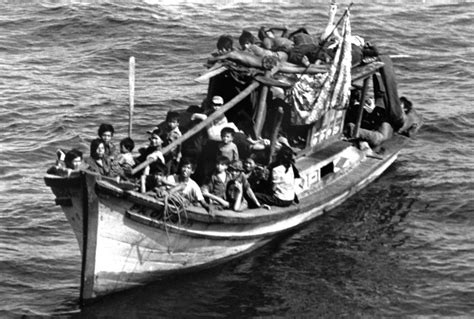 refugee c boat port bow view of a boat filled with vietnamese refugees a