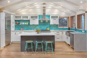 remodeled kitchen w wavy turquoise backsplash white