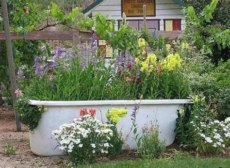 bathtub flower bed using an old bathtub as a container in your garden a