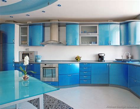 blue kitchen ideas a metallic blue kitchen with modern curved cabinets