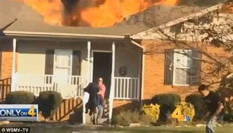 dog house nashville tennessee good samaritan stops car and runs into burning house to save family dog