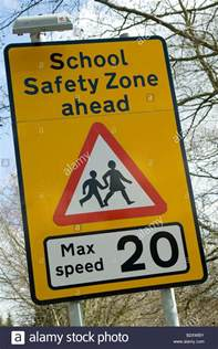 Maximum Speed Sign Warning Of School Safety Zone Ahead With A Maximum