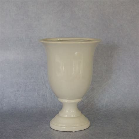 white ceramic urn white ceramic urn flamboijant decor hire