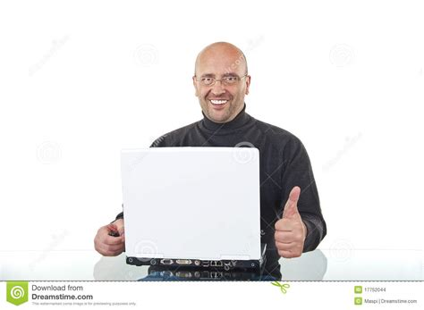 Man Sitting At A Desk Happy Man Sitting At Office Desk With A Laptop Stock