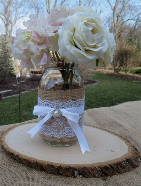 Decorated Mason Jar and Wood Slice Wedding Centerpieces