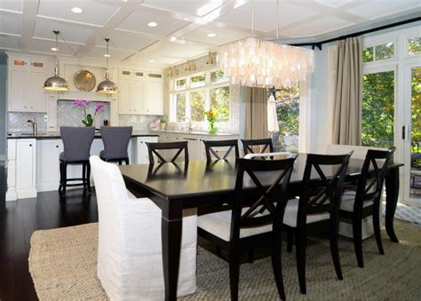 Kitchen And Dining Room Flooring by Open Plan Soft White Cabinets Contrasting Floors