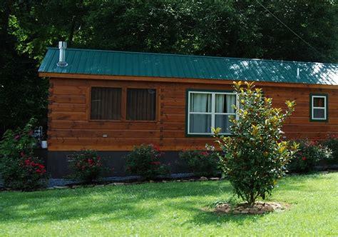 log cabin with brick underpinning studio design