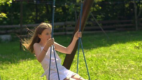 the swing years cute child on swing little boy rides on swing on children